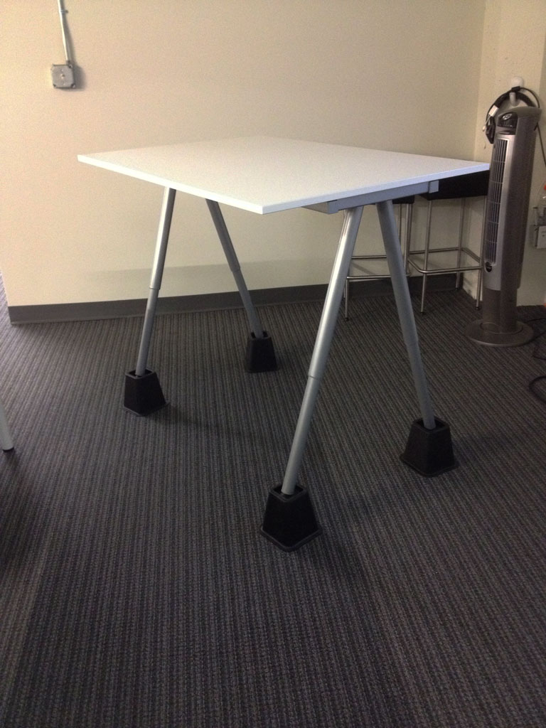 Code fellows s diy ikea standing desk with bed risers for Table risers ikea